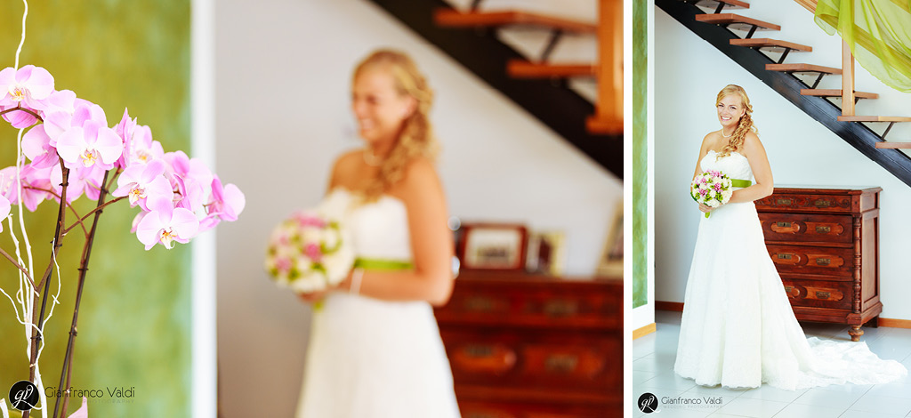 la sposa indossa il vestito per il suo matrimonio